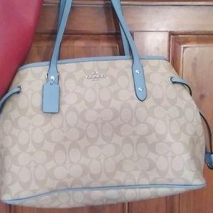 Light blue khaki Coach drawstring bag